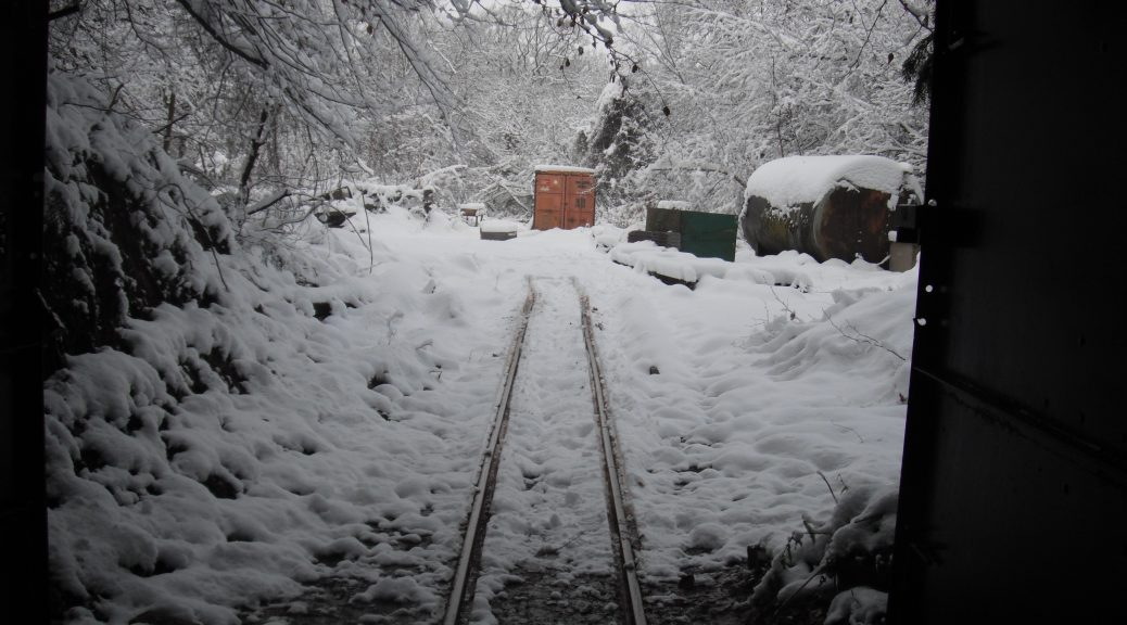 Looking out of the mine into snow